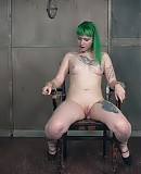 Brutal Paige Pierce has the body of a sweet angel, but she's taken it on an alternative ride. Green hair, split tongue, tattoos, and piercings.